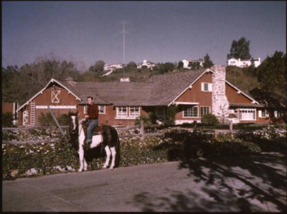 Dad on horse in front of Mandeville house-smallest